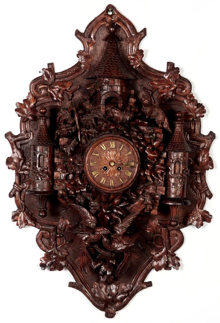 A HIGHLY CARVED BLACK FOREST CASTLE WALL CLOCK