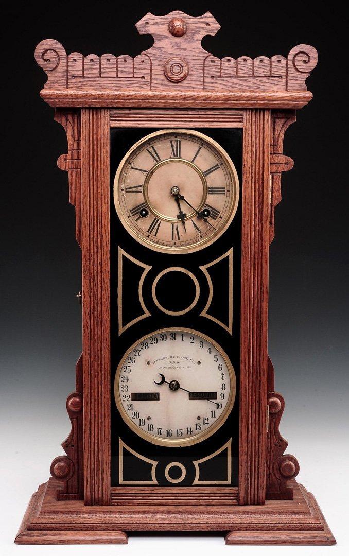 WATERBURY NO. 44 OAK CASE DOUBLE DIAL CALENDAR CLOCK