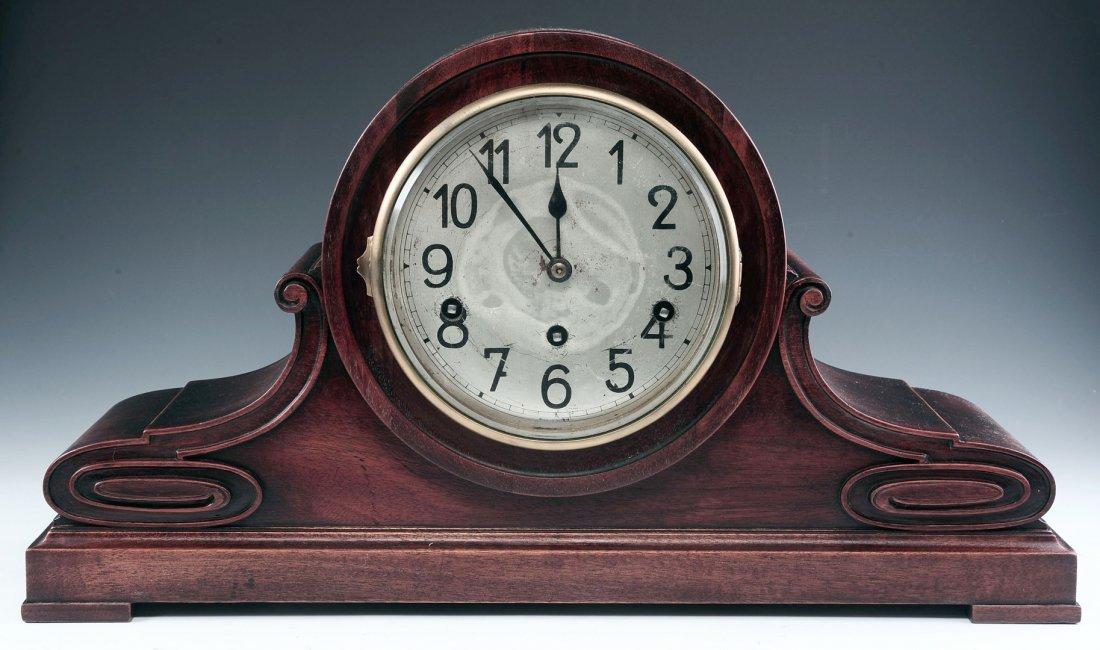A QUARTER HOUR STRIKING MAHOGANY TAMBOUR CLOCK
