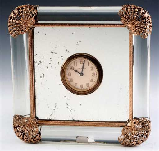 A Vintage New Haven Glass Tube Mirror Clock