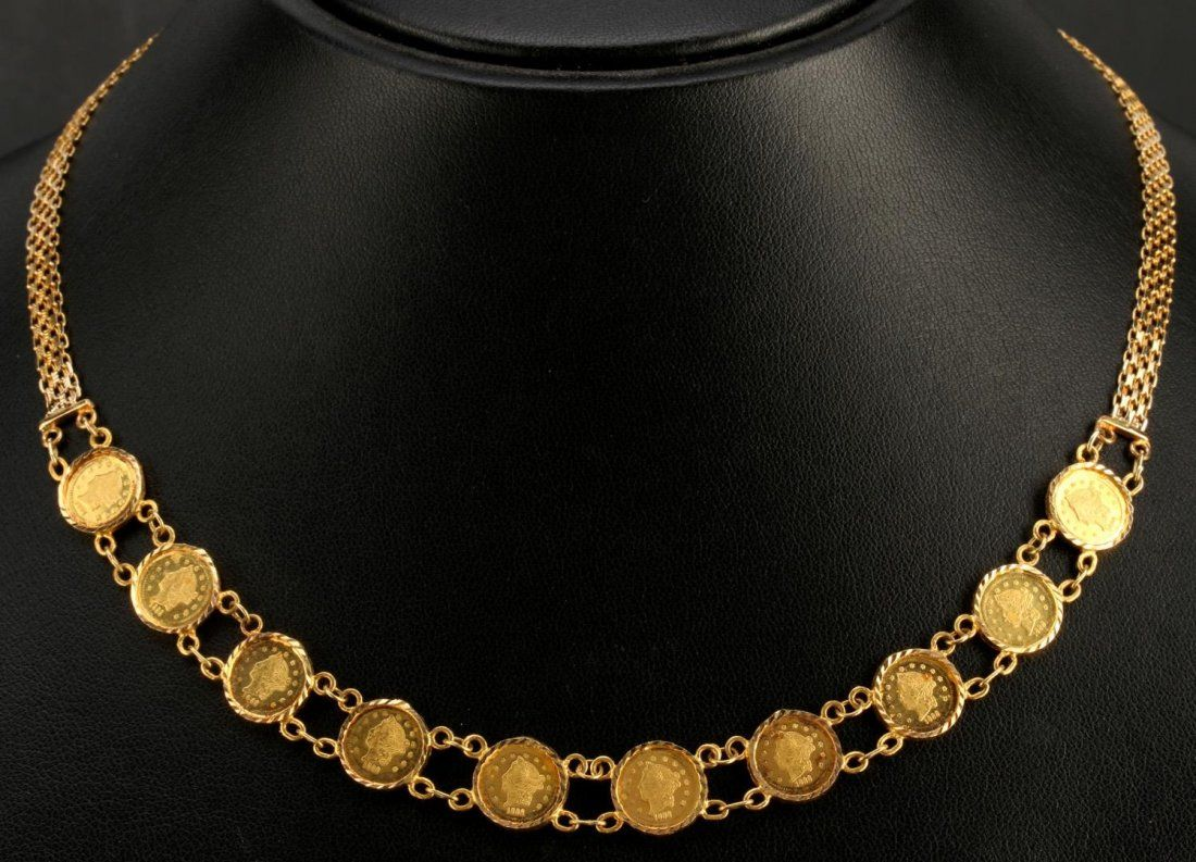 A 14K GOLD BISMARK LINKNECKLACE WITH 12 GOLD COINS