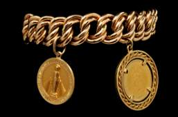 A 14K CURB LINK BRACELET WITH CHARM AND COIN