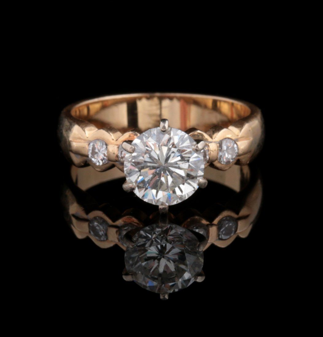 A ONE CARAT DIAMOND SOLITAIRE ENGAGEMENT RING