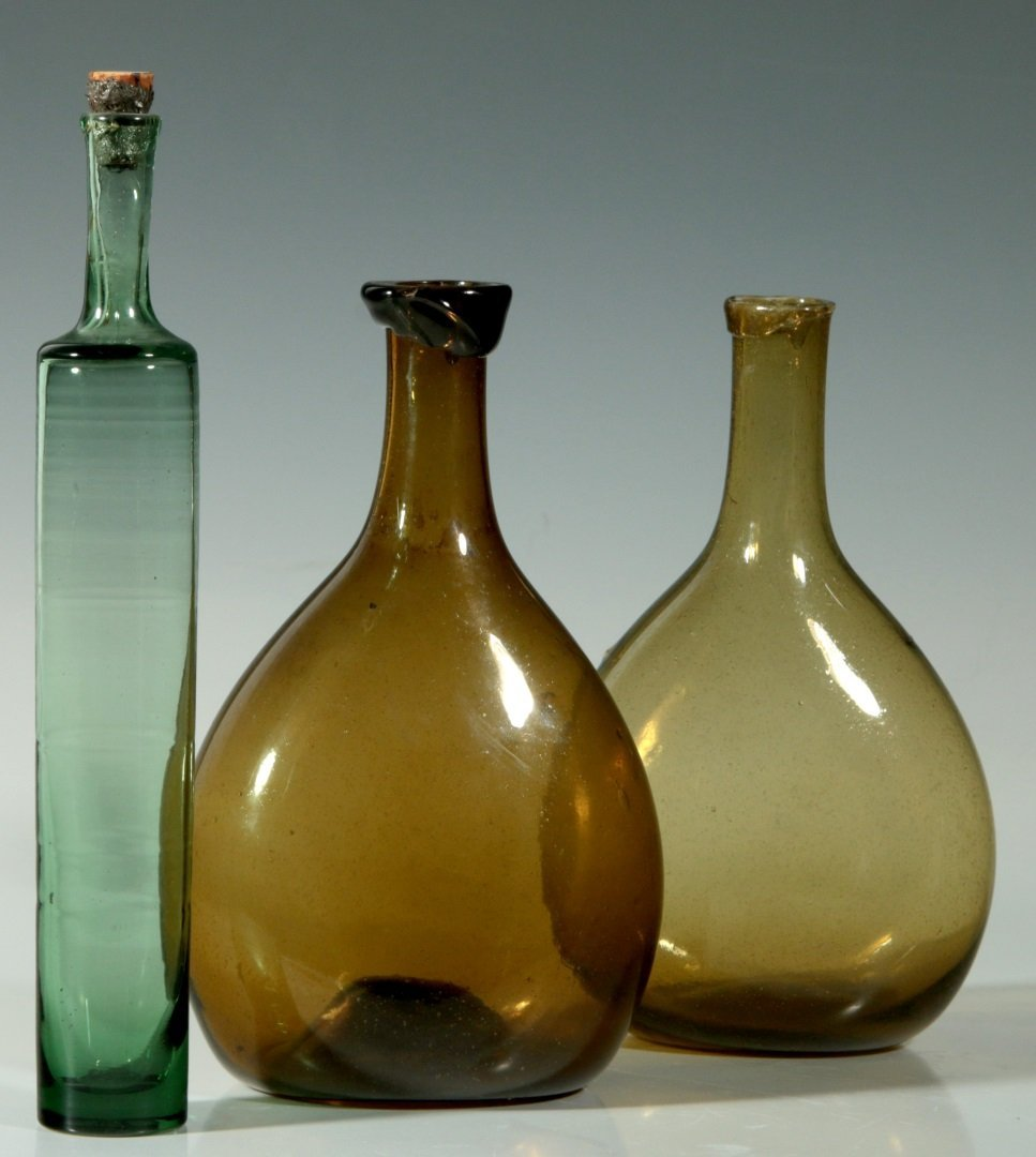 A 19TH C. FREE BLOWN CHESTNUT FLASK, PLUS ANOTHER