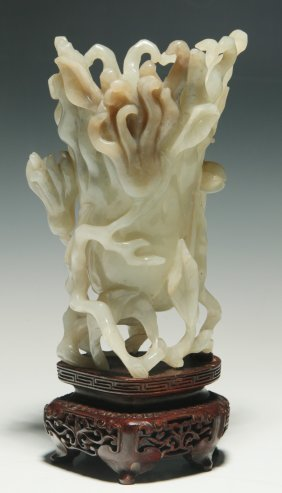 A QING DYNASTY OR EARLIER CHINESE CARVED JADE RYTHON