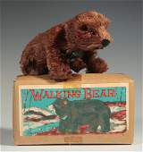 A VINTAGE PLUSH COVERED WIND UP WALKING BEAR TOY