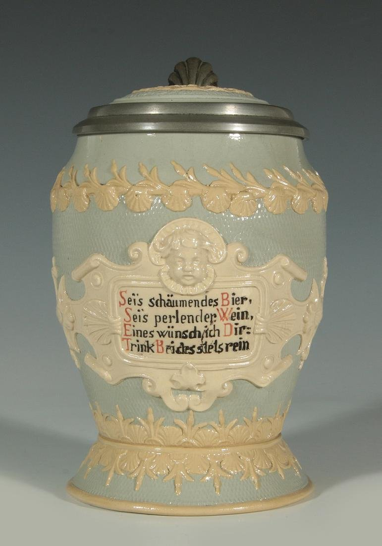 A METTLACH 1/2 L. STEIN #1727 WITH INLAID LID