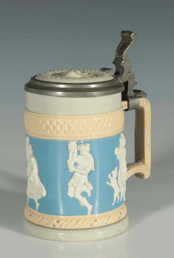 A METTLACH CAMEO RELIEF STEIN #171 WITH INLAID LID