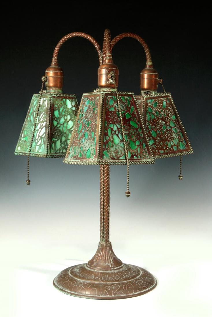 A PATINATED BRONZE TABLE LAMP ATTRIBUTED RIVIERE