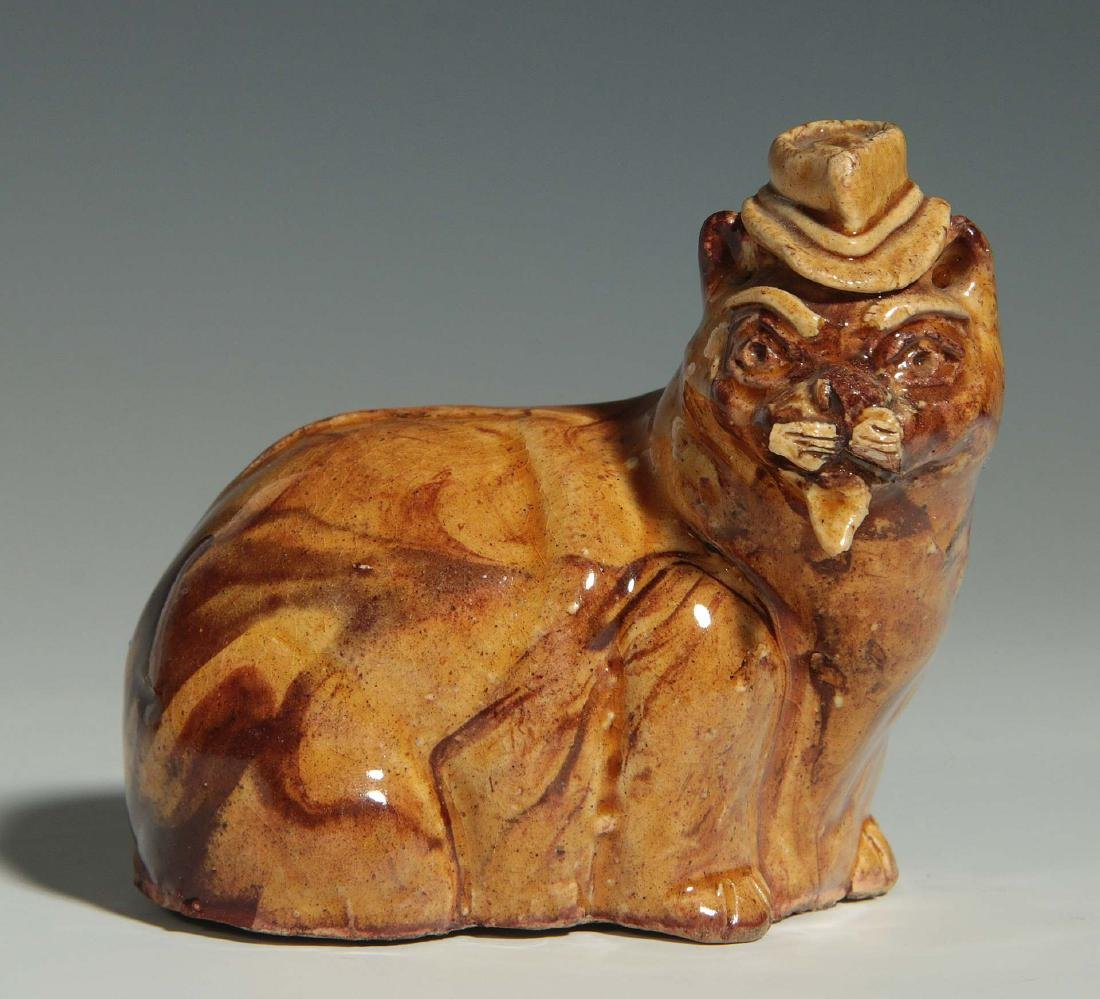 A 19TH CENTURY YELLOW WARE POTTERY CAT