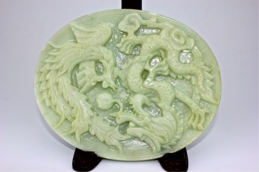 Jade carved plate with dragon and ocean.