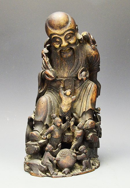 A Chinese Bamboo Statue of Shoulao with Children