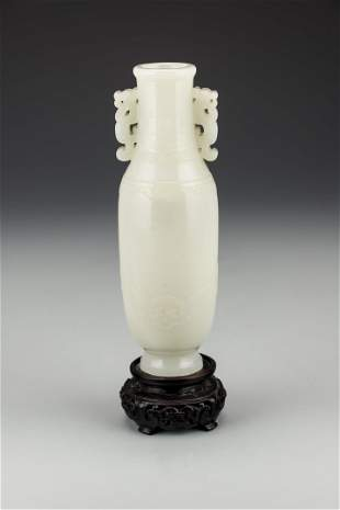 A Chinese White Jade Baluster Vase with Stand, Qianlong