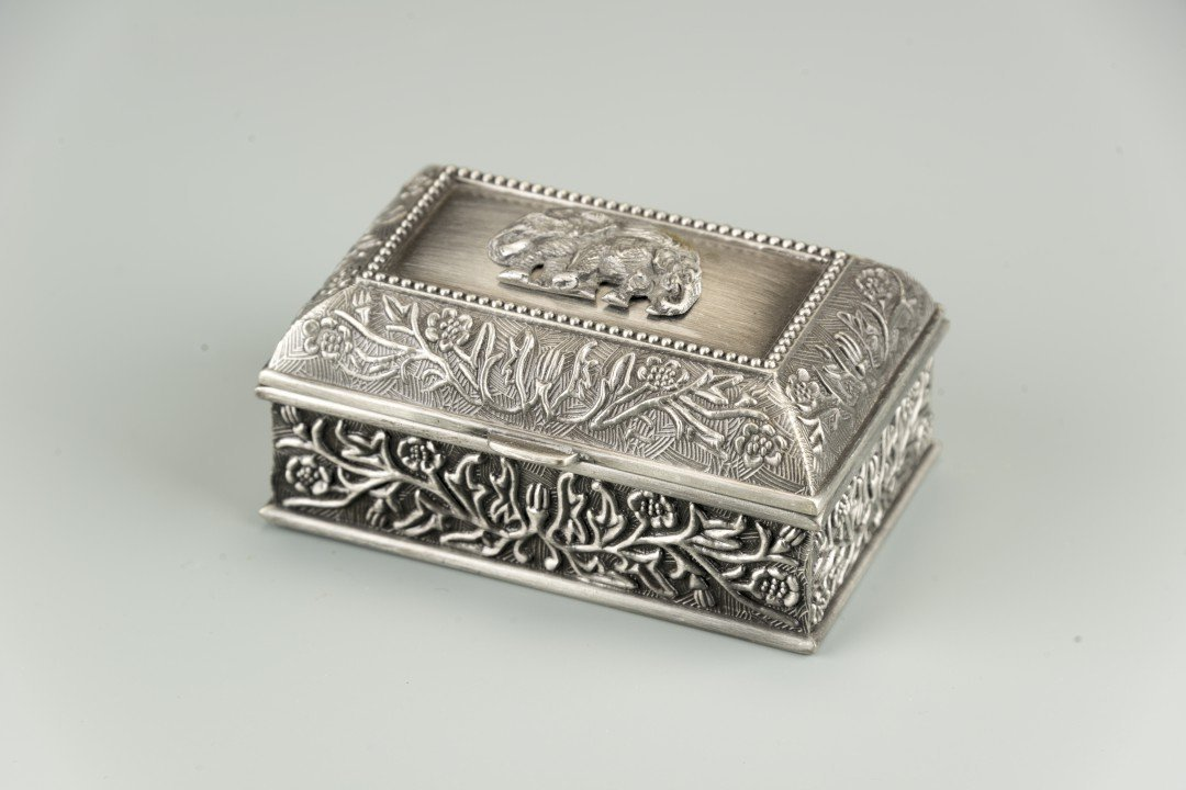 A Small Pewter Box with Elephants