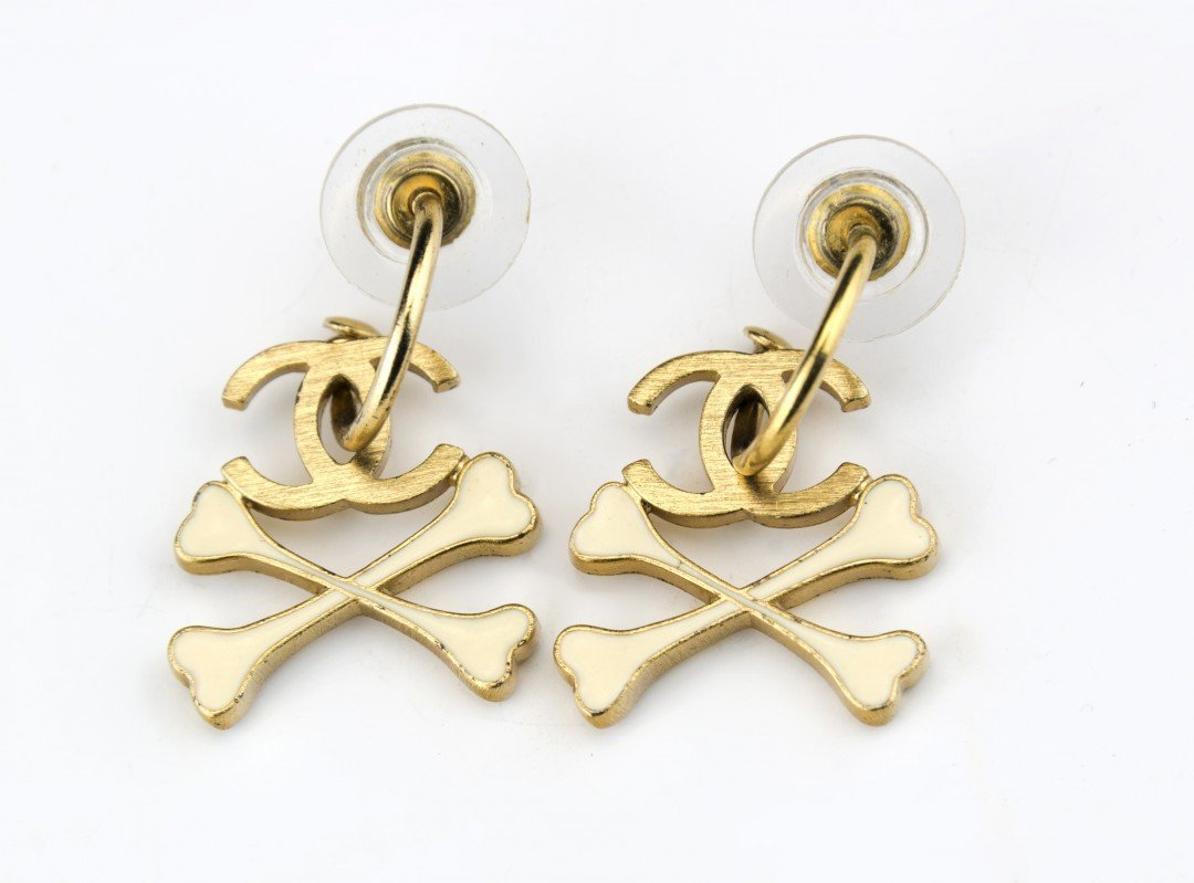 A Pair of Chanel Earrings with Cross Bones