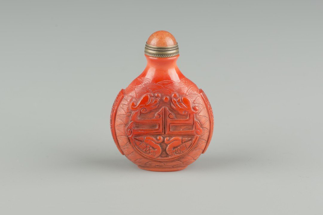 A Carved Chinese Red Peking Glass Snuff Bottle