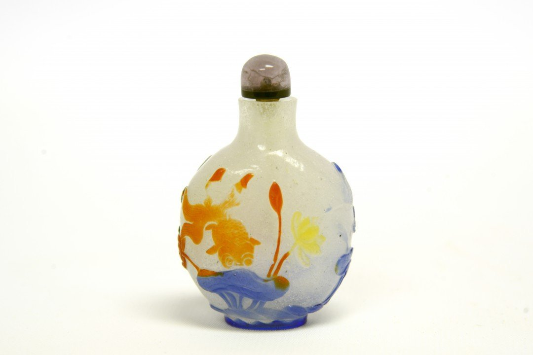 A Chinese Peking Glass Overlay Snuff Bottle