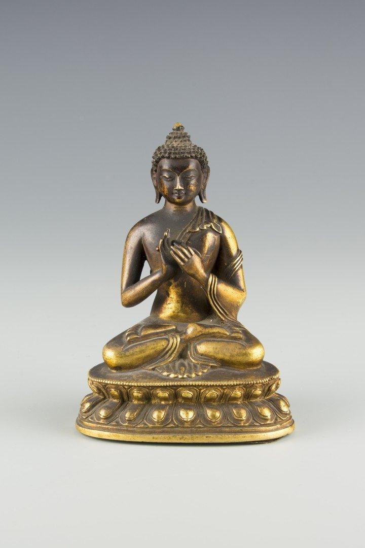 A Small Bronze Statue of Sitting Buddha