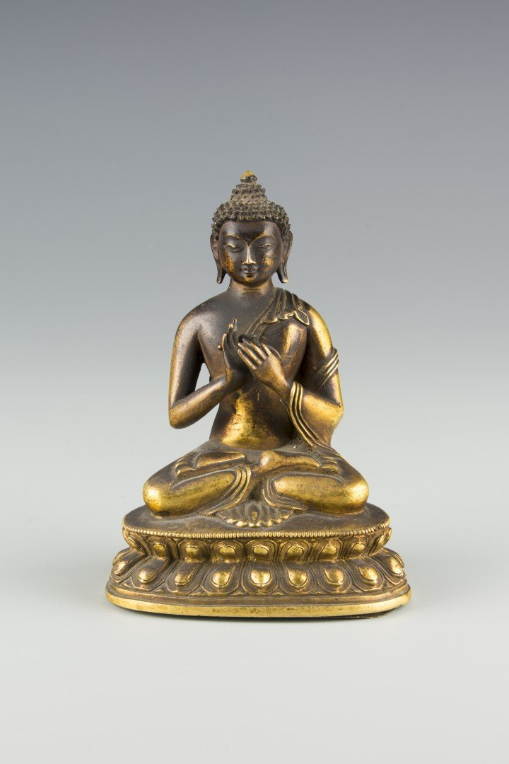 A Small Bronze Statue of Sitting Buddha
