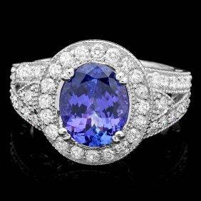 3A: 14k Gold 3ct Tanzanite 1.10ct Diamond Ring
