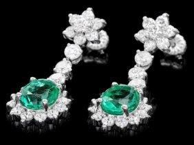 1RN: 14k Gold 4ct Emerald 3.20ct Diamond Earrings