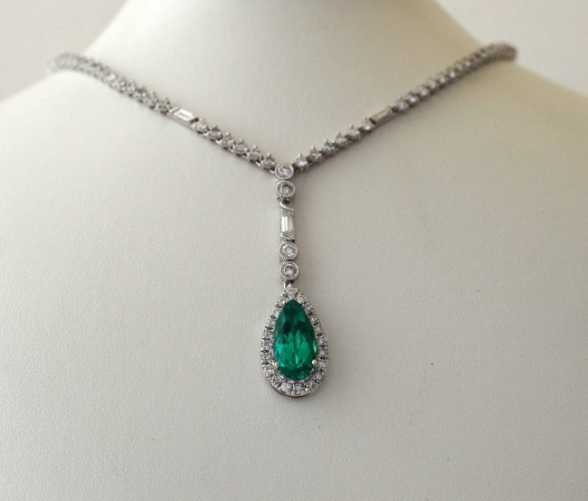 18KT Gold, 2.23ct Emerald & 3.43ct Diamond Necklace