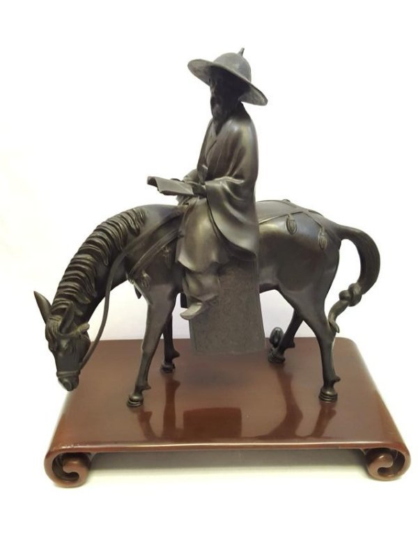 A Chinese bronze statue of Toba on mule