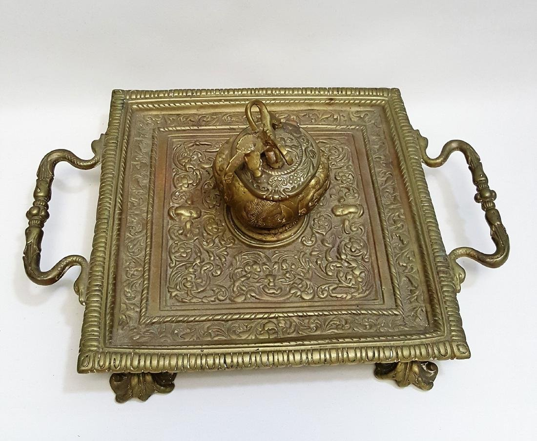A heavy antique brass inkwell highly detailed