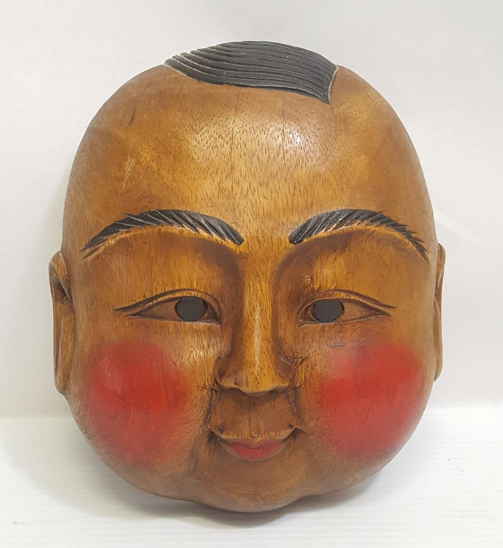 Buddha face wooden mask