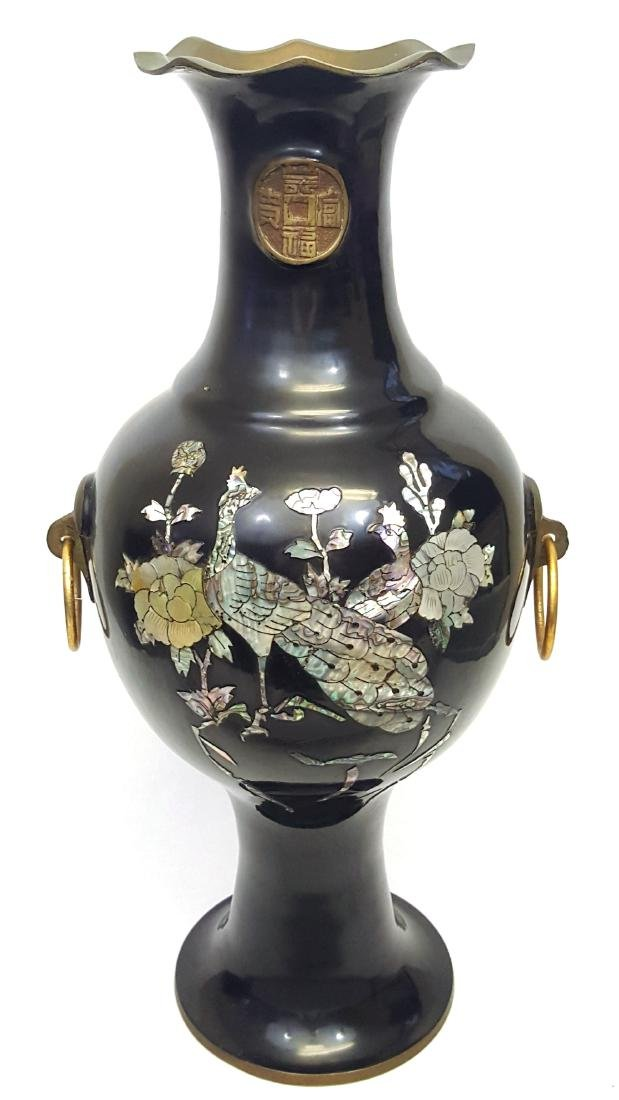 A vintage Japanese brass vase with black lacquer and