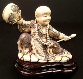 Mammoth Ivory Boy Play Wooden Fish