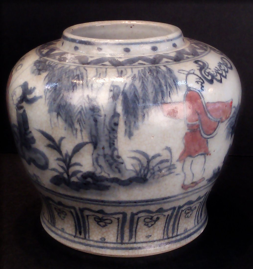 A BLUE AND WHITE PORCELAIN JAR WITH IRON RED PAINT
