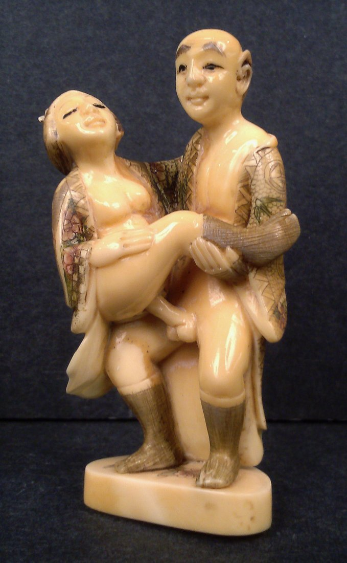 A HIPPO IVORY CARVING NETSUKE OF EROTIC GROUP