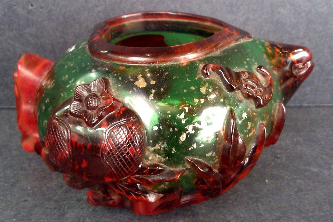 A PEKING GLASS PEACH WASHER WITH RED CARVINGS AND GREEN