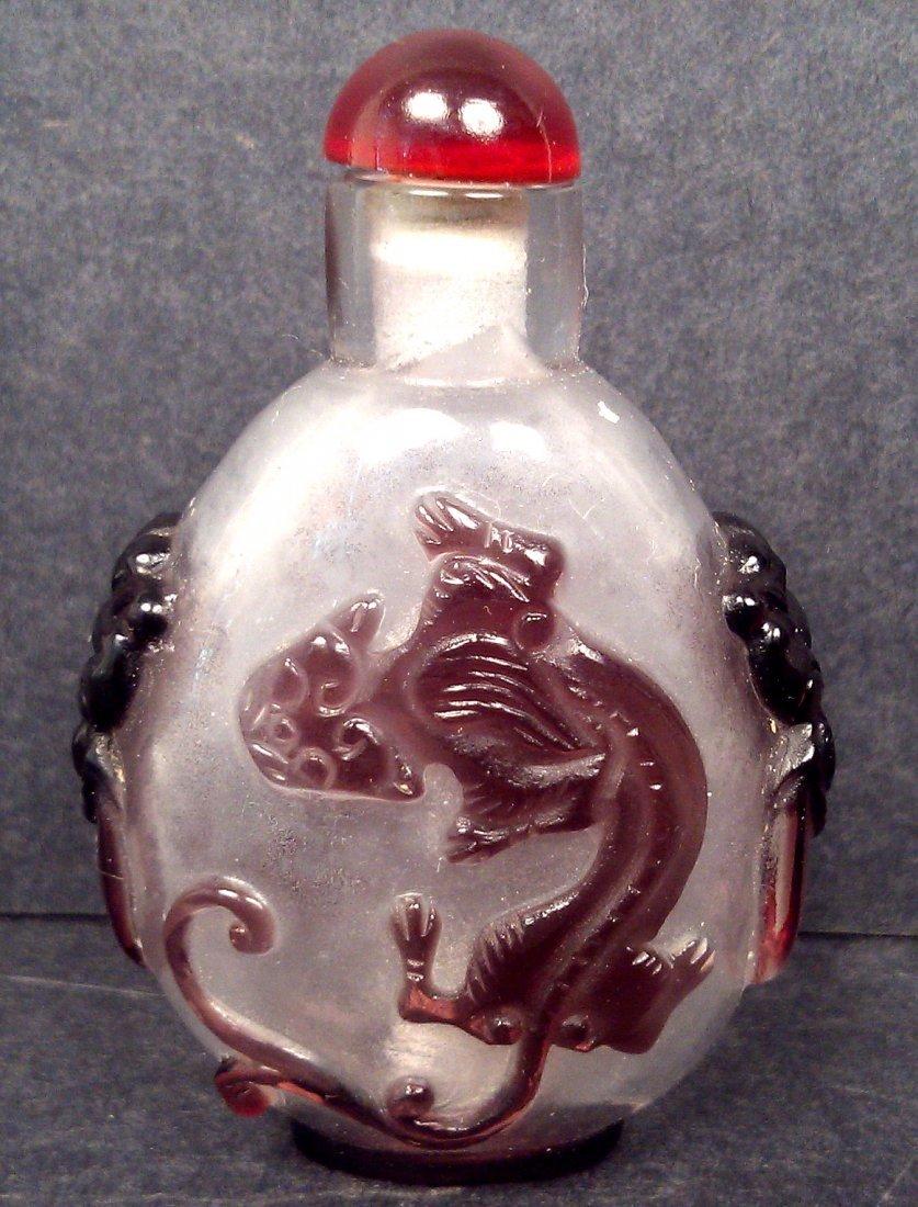 A PEKING GLASS LION SNUFF BOTTLE