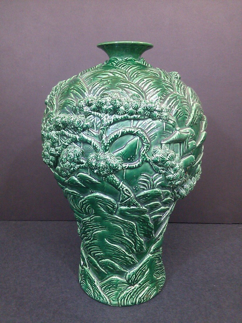 A Qing dynasty green glazed carved porcelain vase-