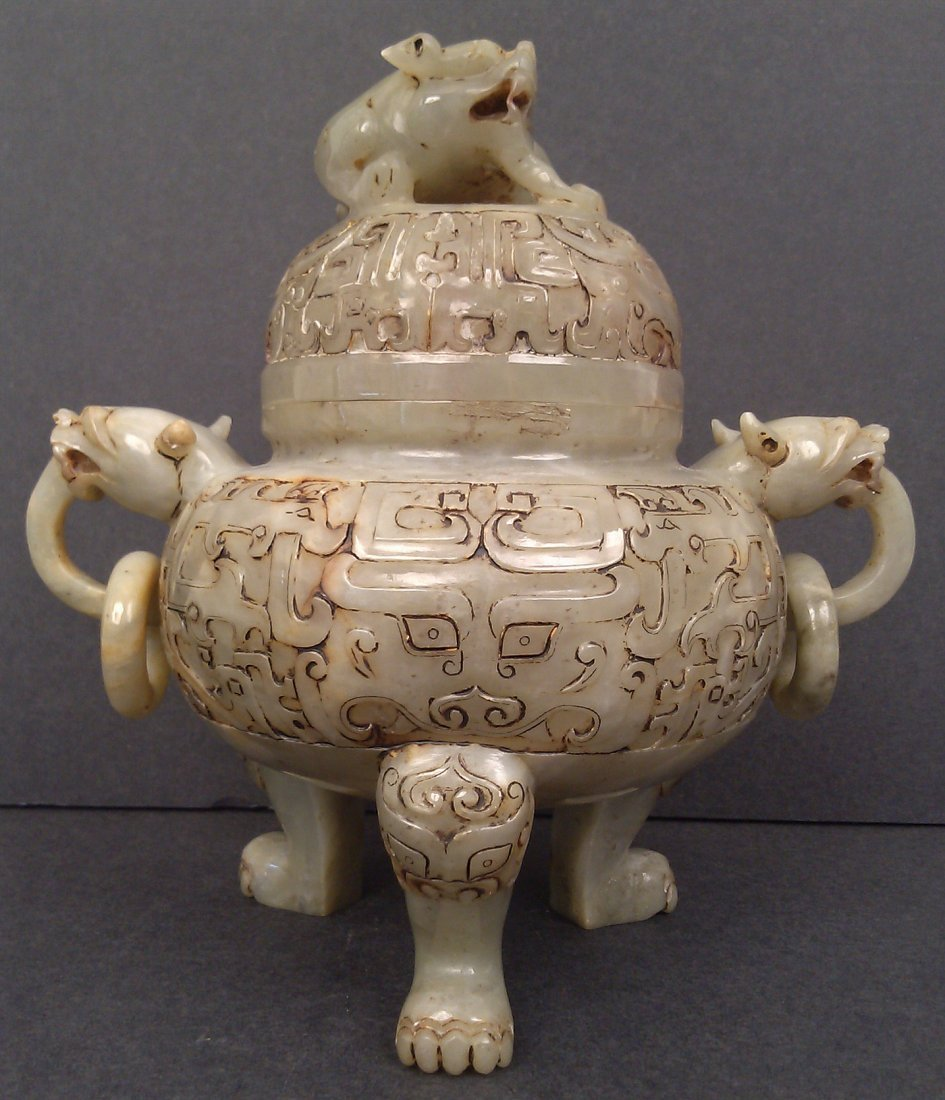A jadeite carved incense burner with lion top and