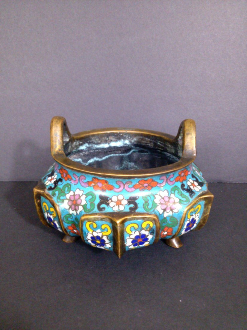A Qing dynasty cloisonne' over bronze incense burner.