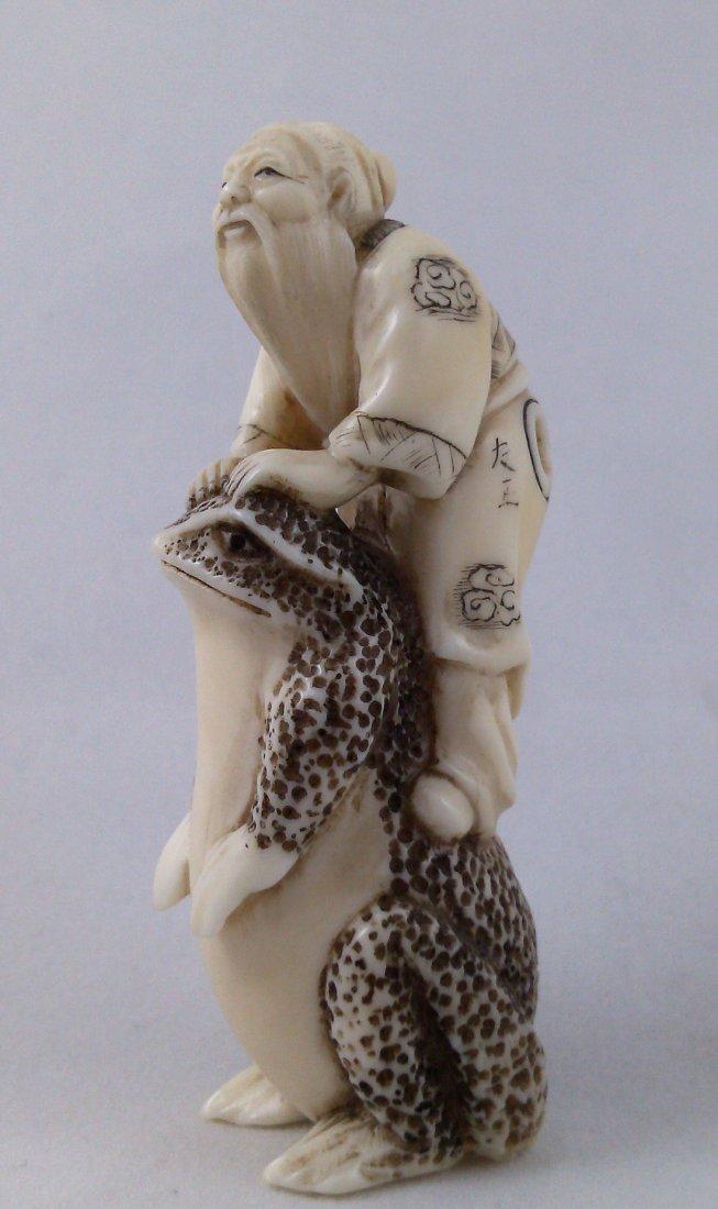 A carving ivory netsuke of magic toad carrying liu Hai