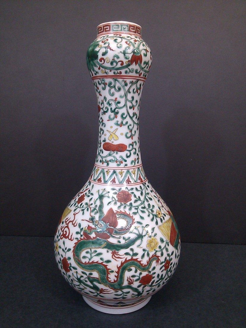 A Ming dynasty porcelain garlic-head dragon bottle