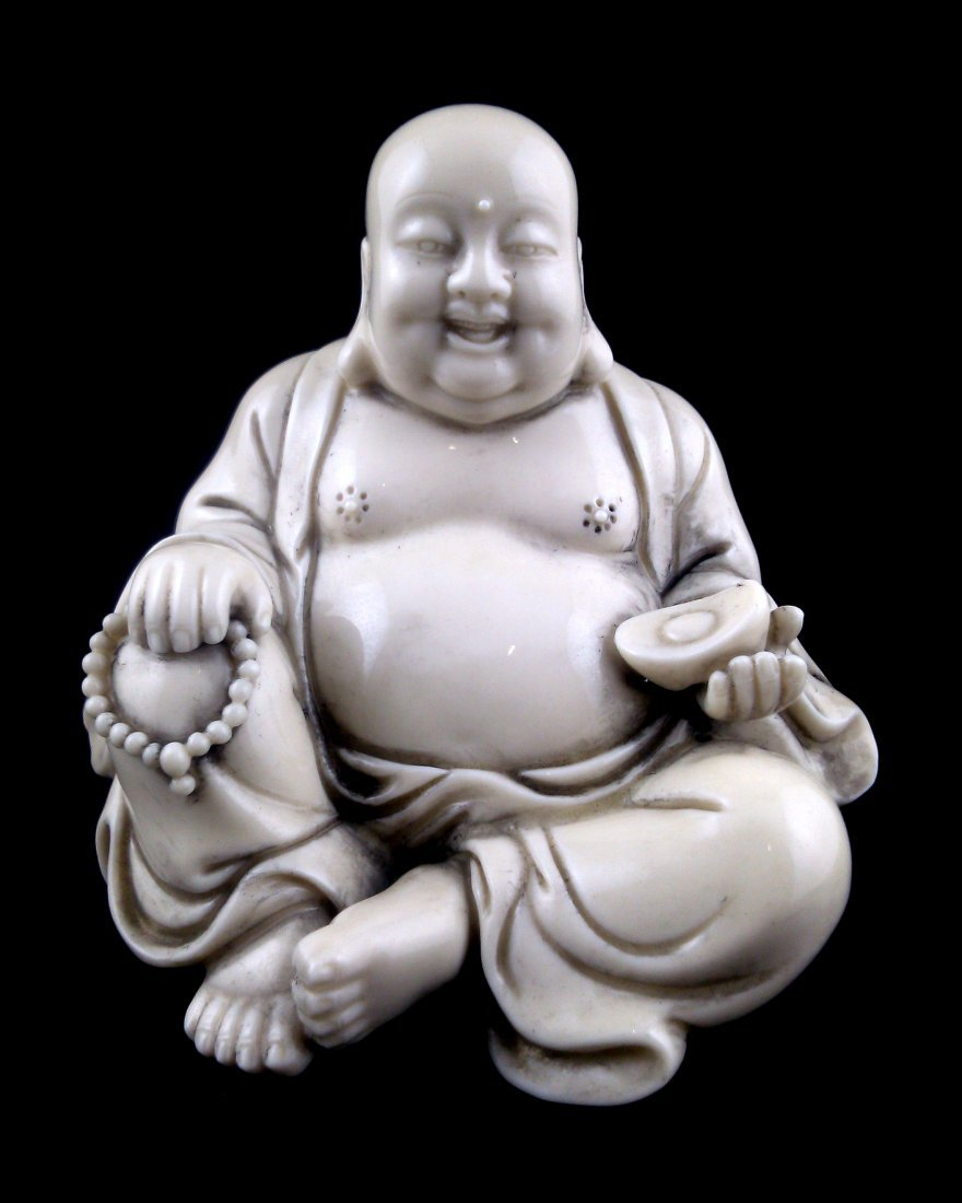 A blanc de chin porcelain figure of a seated happy
