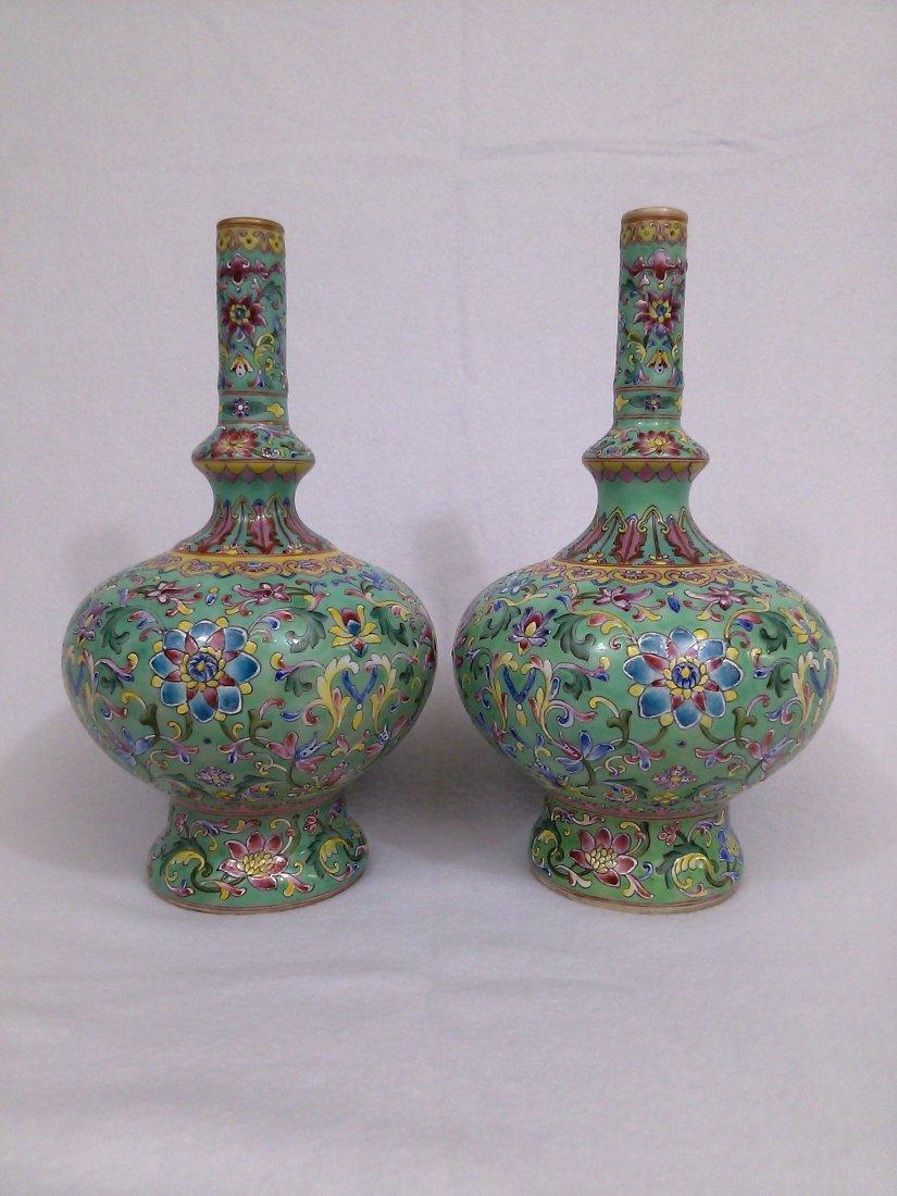 A Qing dynasty pair of green porcelain bottle vases-
