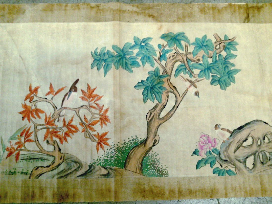 A scroll painting of pairs of birds and trees with poem