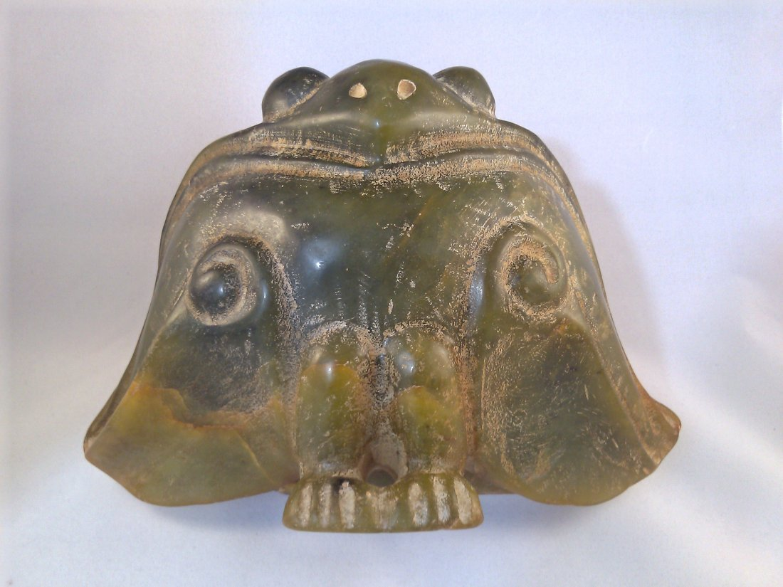 A Hongshan culture Neolithic period carved yellow jade
