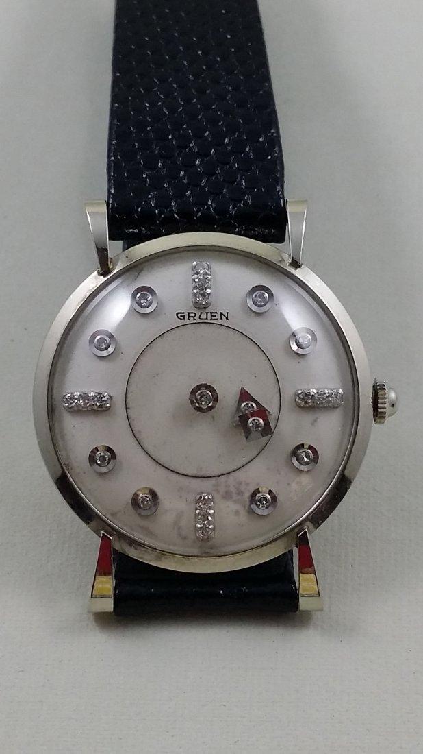 Gruen Mystery 14K Gold Watch