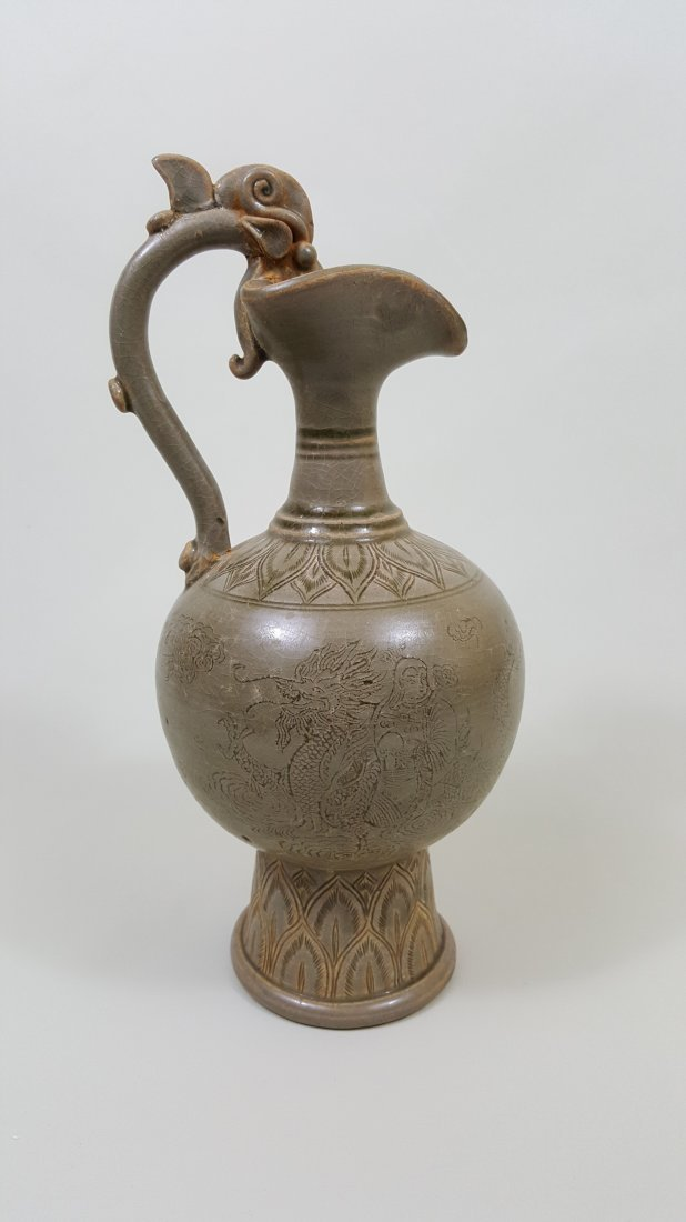 A Tang dragon handle celadon porcelain ewer