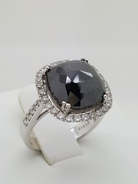 A Cushion Cut Black Diamond Ring In 18k White Gold And