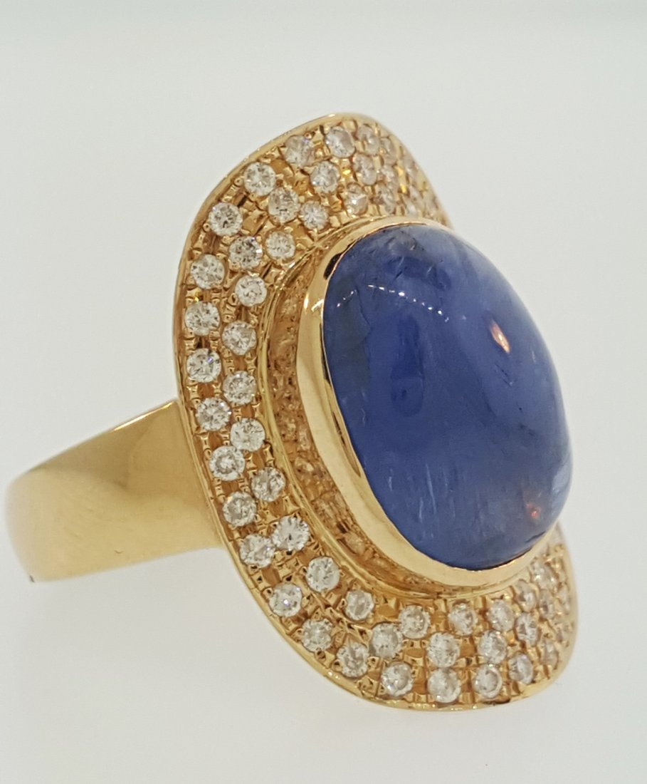 A 18K Yellow Gold Large Cabochon Burma Sapphire Ring-