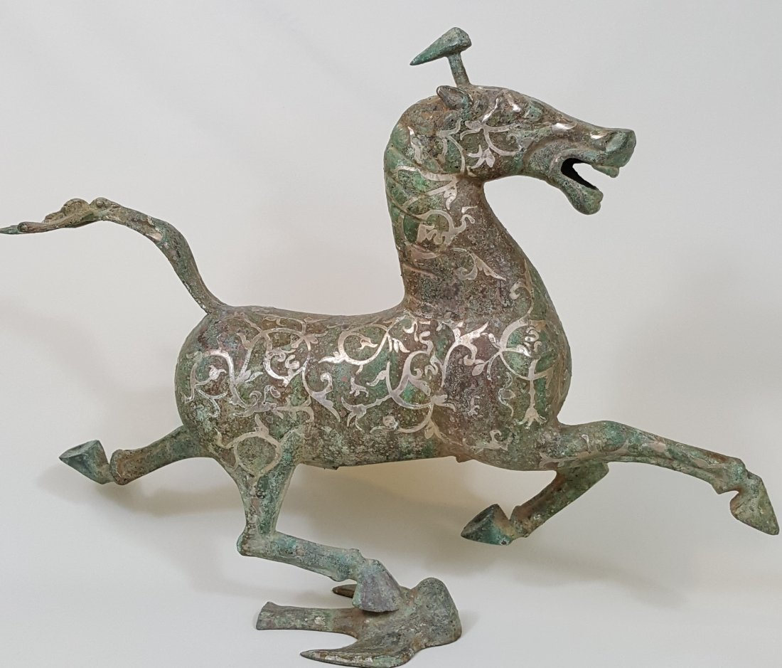 A large bronze Flying Horse with silver inlay- Han