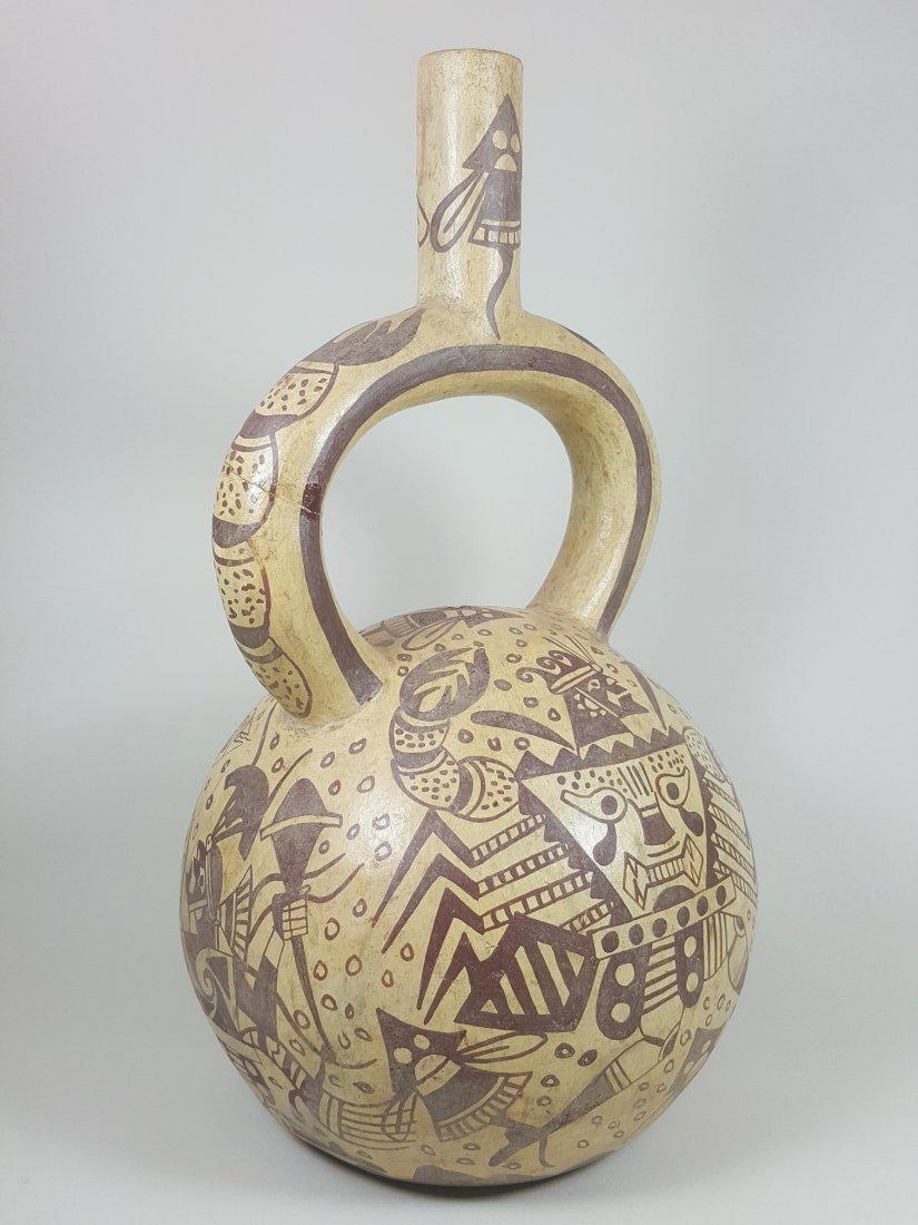 A stirrup-spouted Mochina vessel, ancient Peru